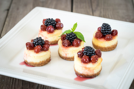 mini: Mini cheesecake with cherry and blackberry on a plate for your design Stock Photo