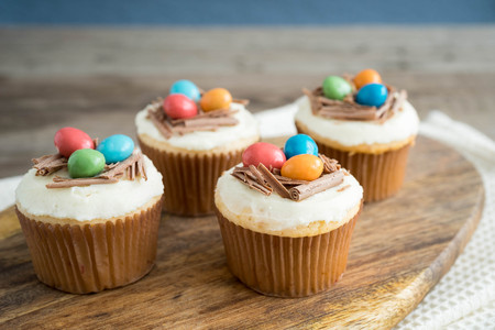 Easter cupcakes with chocolate frosting and candy eggs