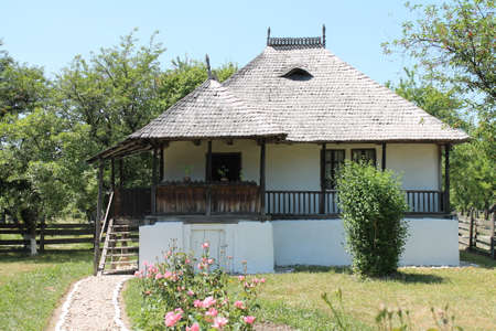 path cottage garden: Traditional romanian house Editorial