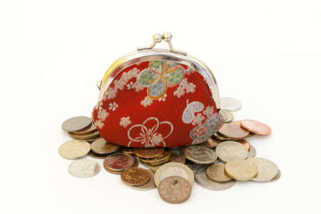 Old fashioned red purse with flowers, and coins.