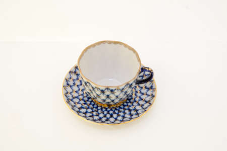 cobalt: Coffee cup and saucer production of the Imperial (Lomonosov) Porcelain Factory. Branded cobalt mesh with gold ornament.