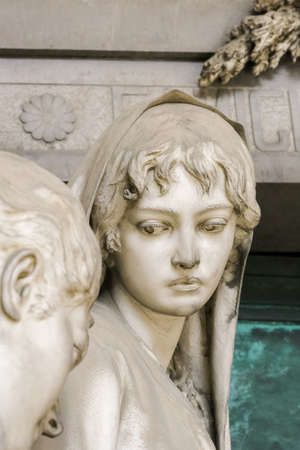 monumental cemetery: Statue of a grieving girl on monumental cemetery of Staglieno in Genoa.