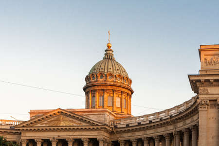 sobor: Kazan Cathedral of St. Petersburg in the bright light of sunset.