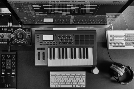 rec: Flat top lay home music studio dj and producer equipment on the black table (Black and white) Stock Photo