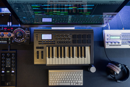 Flat top lay home music studio dj and producer equipment on the black table