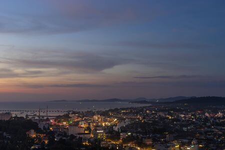 DUONG DONG, PHU QUOC, VIETNAM - NOVEMBER 21, 2017: Aerial view from above on night town, streets and bay