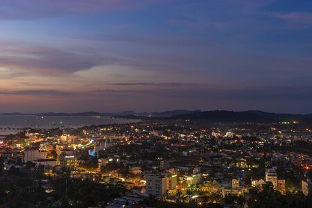 DUONG DONG, PHU QUOC, VIETNAM - NOVEMBER 21, 2017: Aerial view from above on night town, streets with lights and bay