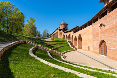 The territory of Nizhny Novgorod Kremlin. View on tower and the Kremlin red wall at summer