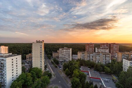 RUSSIA, MOSCOW, TROITSK - JUNE 28, 2018: View from the high on Polkovnika Militsii Kurochkina street, Mikroraion V district and forest horizon at sunset time in summer