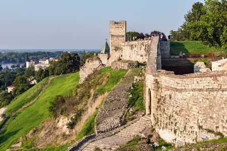 SERBIA, BELGRADE - JULY 11, 2018: People tourists standing on wall of fortress Kalemegdan in summer day