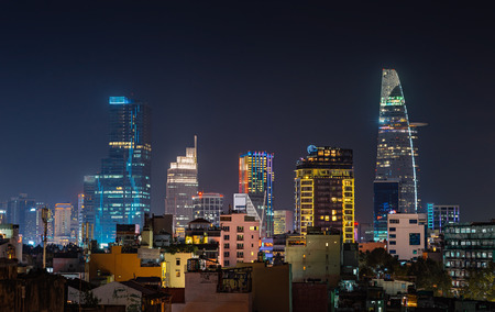 Urban night skyline view of Ho Chi Minh city in Vietnam. Front view on colored skyscrapers in downtown