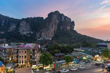 Ao Nang, Krabi Province, Thailand - January 22, 2019: View on big cliff and street in the evening at sunset twilight 新聞圖片