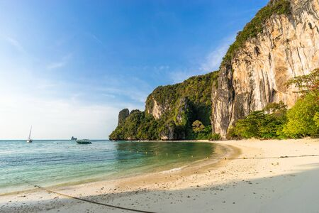 Seashore and big cliff on tropical sandy Pelay Beach on Koh Hong Island in Krabi in Thailand in the morning sun light