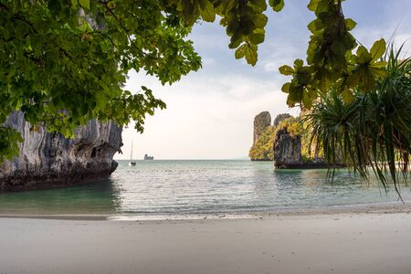 View on sea and Pelay beach through tropical trees and greenery on Koh Hong Island in Thailand Banco de Imagens