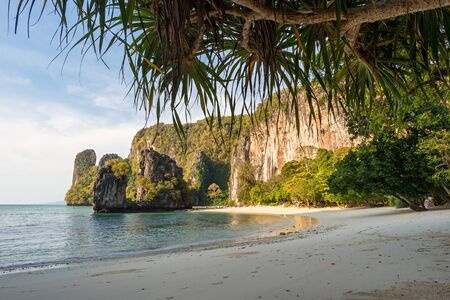 Vacations on beautiful tropical sandy Pelay Beach with big cliff and greenery on Koh Hong Island in Krabi in Thailand