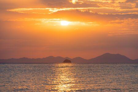 Golden sunset over sea horizon
