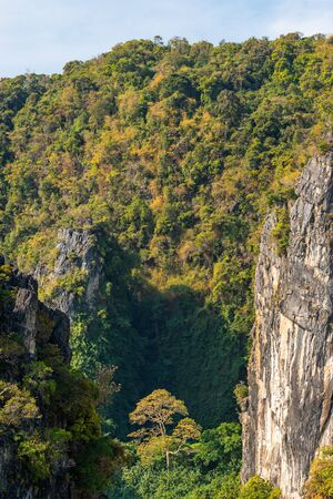 Close-up view of the tropical nature of Hong island, textured rocks and cliffs in Thailand