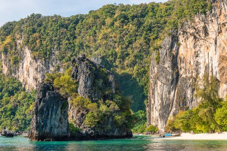 Tropical rocky Pelay Beach with big cliffs and bay of water on Koh Hong Island in Thailand