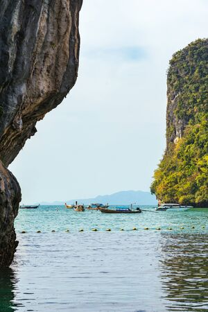 View on sea, cliffs and boats in water from Koh Hong Island in Krabi in Thailand Banco de Imagens