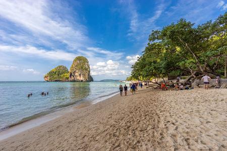 Phra Nang beach, Krabi Province, Thailand - January 18, 2019: People walks on the beautiful asian sandy beach and resting on the sea shore