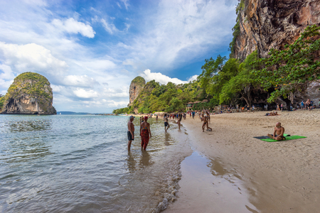 Phra Nang beach, Krabi Province, Thailand - January 18, 2019: People walks on the beautiful asian beach and resting on the sea shore Editorial