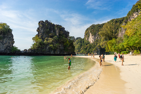 Koh Hong, Krabi Province, Thailand - January 22, 2019: People walk, swim and relax on beautiful tropical sandy Pelay Beach in sunny day
