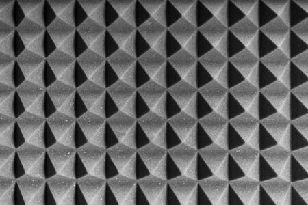Grey acoustic foam pyramid repeating background for music Studio. Black and white. 版權商用圖片