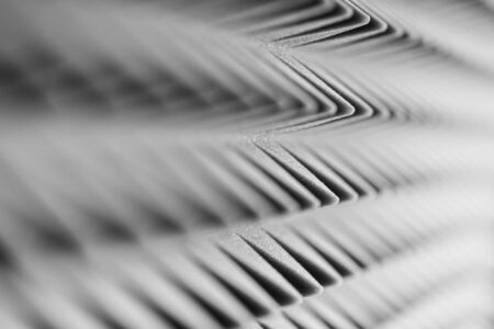 Grey acoustic foam pyramid repeating background for music Studio. Black and white. Close-up view with shallow depth of field 版權商用圖片