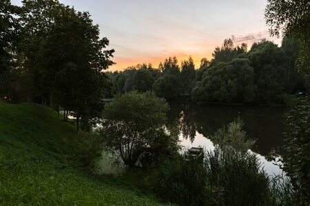 Landscape of russian nature and Desna river among greenery and trees in summer twilight in Zarechie park in Troitsk