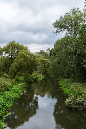 Landscape view on Pahra river among greenery and trees in Russia in summer cloudy day 版權商用圖片