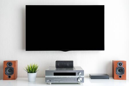 Home entertainment multimedia center in living room: tv, audio system and over devices