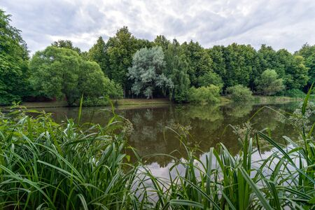 Landscape view on Desna river among greenery and trees in Russia in summer cloudy day in Zarechie in Troitsk city