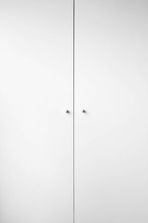 White cabinet closed doors with white handles background with space for text