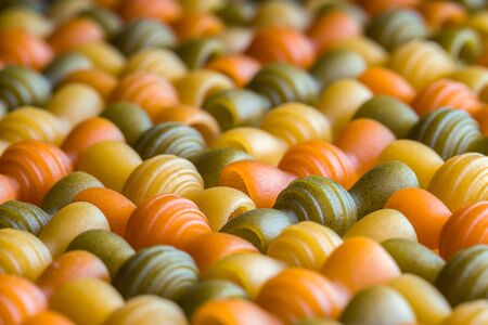 Raw dry uncooked color pasta spaghetti detailed pattern background 版權商用圖片