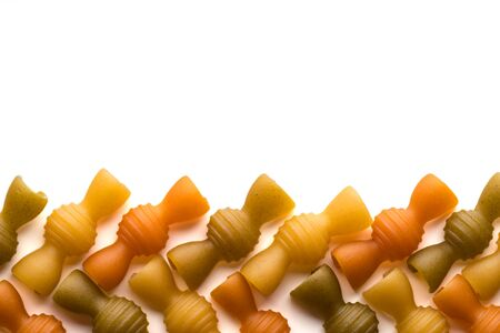 Colored italian pasta isolate on white background. Flat lay top view with space for copy. Close-up