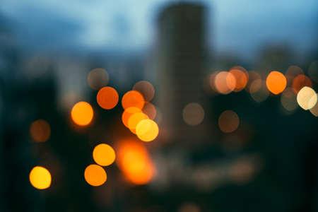 Bokeh lights on city street defocused background