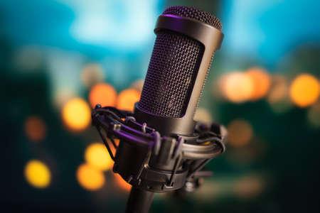 Professional studio microphone on blurred bokeh lights background 版權商用圖片