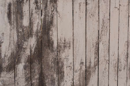 Old boards are completely dirty in white shabby paint.