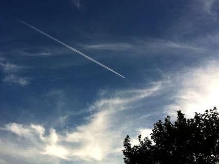 vapour: Vapour trail in sky Stock Photo