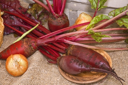 beets with greens and onions on the table