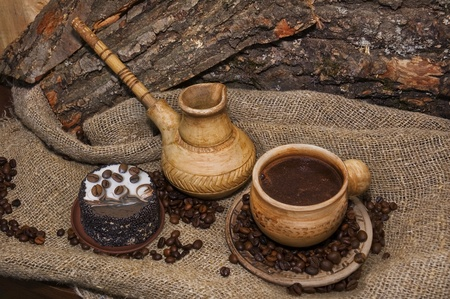 cezve: coffee from cezve and cake of coffee beans Stock Photo