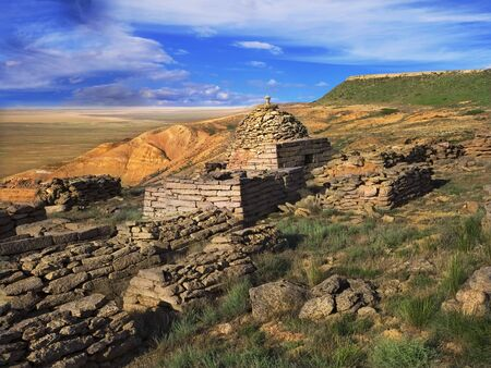 Ruins of an ancient Muslim cemetery, against the backdrop of plateau Ustyurt in Kazakhstan
