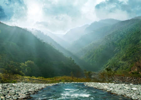 gray blue mountain ranges in the haze and flowing river  Himalaya, Uttarakhand