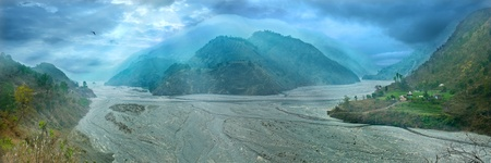 watercourse: panorama of the wide watercourse river with mountain ranges in the middle. Uttarakhand, Haidakhan, Gola river Stock Photo