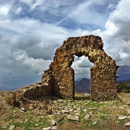 the ruins of the old stone gate at high altitudes in the Himalayas