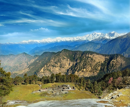 high mountain ranges of the Himalayas and the old abandoned village with stone houses  India, Uttarakhand