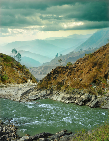 mountain river on the background of the misty mountain ranges of the Himalayas
