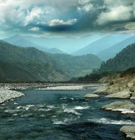Dark cloudy stormy sky over mountain river in the Himalayas