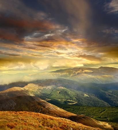mystery dark orange cloudy sky over Carpathians ridges