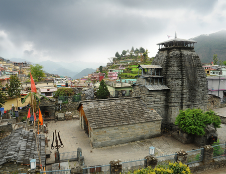 hindu god shiva: Ancient temple of Lord Shiva and rarity trident in the Gopeshwar town in Himalaya Stock Photo
